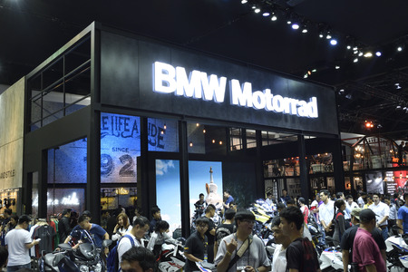 Nonthaburi,THAILAND - April 6, 2018: Crowd in side view of BMW booth exhibition at THE 39th BANGKOK INTERNATIONAL MOTOR SHOW 2018. Sajtókép