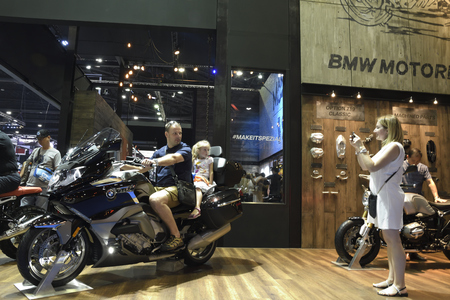 Nonthaburi,THAILAND - April 6, 2018: Family test drive and take photo with BMW motorcycle in BMW booth exhibition at THE 39th BANGKOK INTERNATIONAL MOTOR SHOW 2018. Banque d'images - 108486570