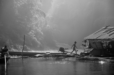 Black and White image, Lifestyle in Surat Thani - Chiew Larn Lake, Khao Sok National Park. Horizontal Black and White image.