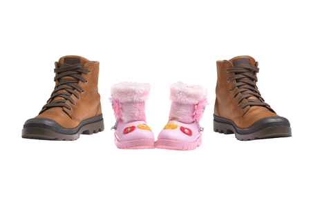 Concept Daddy protects daughter, Couple Brown boot instead of father and pink boot instead of daughter. Isolated color image on white background.