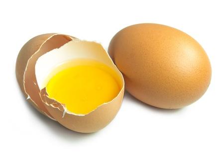 Broken egg on white isolated photo