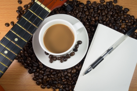 Coffee - mocha with guitar and notebook photo