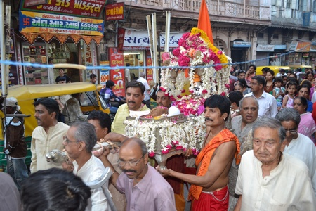 Raipur, Ahmedabad, India on 5th April, 2012 - Carrying Lord Shiva Hatkeshwar on chariot out into the city among the people on the day of incarnation Stock Photo - 13096306