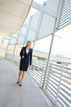 A beautiful businesswoman walking in a business building photo