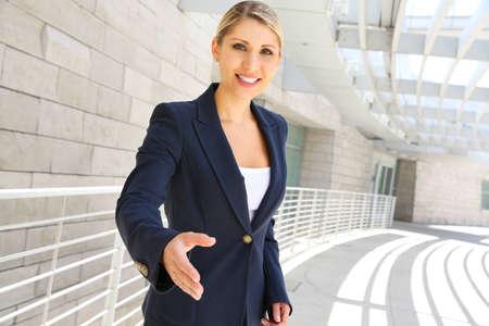 Business woman ready to handshake photo