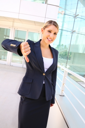 businesswoman shows thumb down