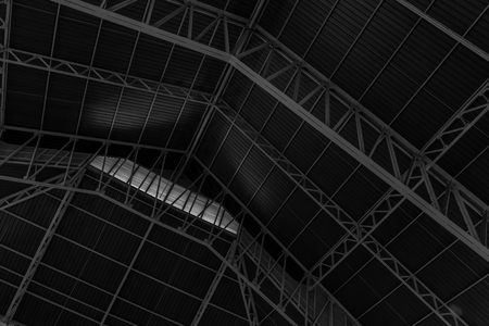 roof framework: Abstract.metal framework of the roof of industrial premises in the enterprise inside view in black and white Stock Photo