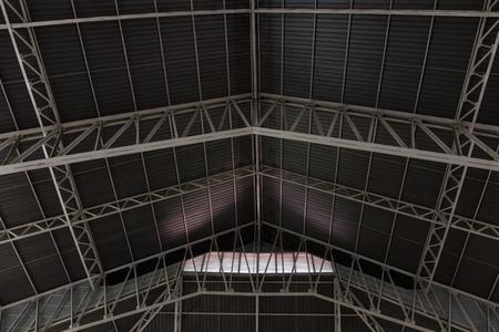 roof framework: metal framework of the roof of industrial premises in the enterprise inside view.