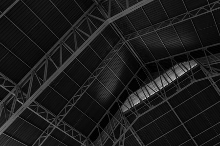 roof profile: Abstract.metal framework of the roof of industrial premises in the enterprise inside view in black and white Stock Photo