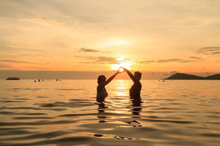 walk in: people walk in Sea Sunset Stock Photo