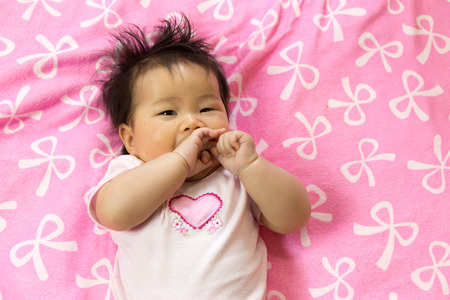 cry baby: Portrait of a sian cute Infant baby girl (baby are three months)