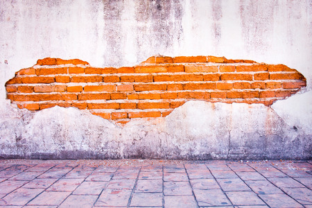 grunge background, red brick wall texture bright plaster wall and blocks road sidewalk abandoned exterior urban background for your concept or project.