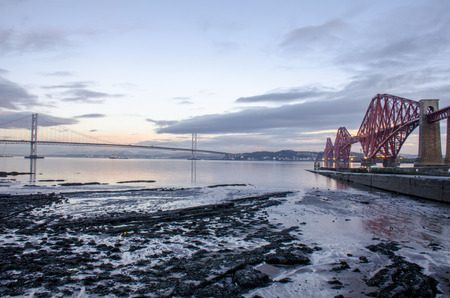 forth: Dawn with two Forth bridges in Edinburgh, UK Stock Photo