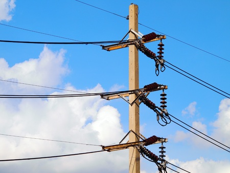 electricity post on blue sky  photo