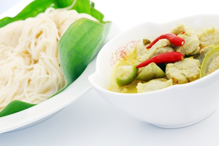 Green curry fish balls and noodles.  Stock Photo