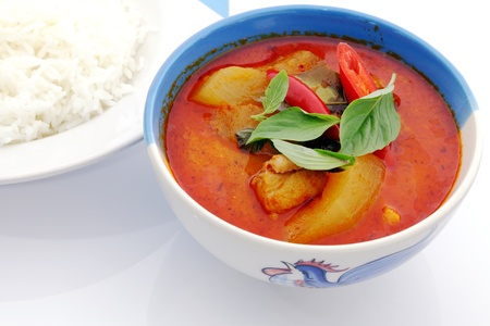 Red curry chicken and rice. photo
