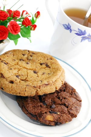 Chocolate chips cookies and hot tea.  photo