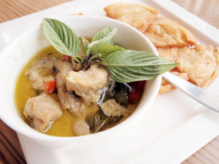 green curry with coconut milk and fried Roti