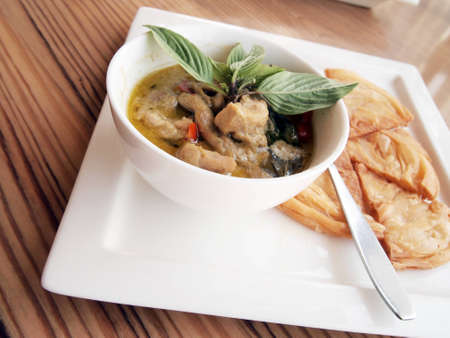 green curry with coconut milk and fried Roti  photo