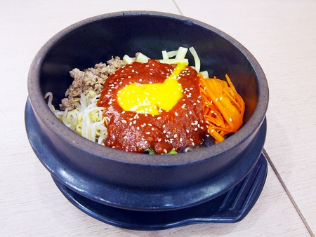 bibimbap in a heated stone bowl, korean dish  photo