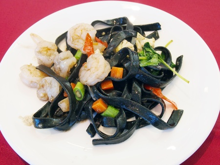 black spaghetti with seafood   photo