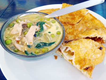 Thai food  green curry with coconut milk and fried Roti photo