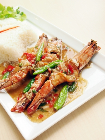 Spicy fried shrimp and white rice  photo