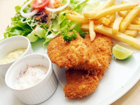 Fried fish with fresh salad and dipping sauce as condiment photo