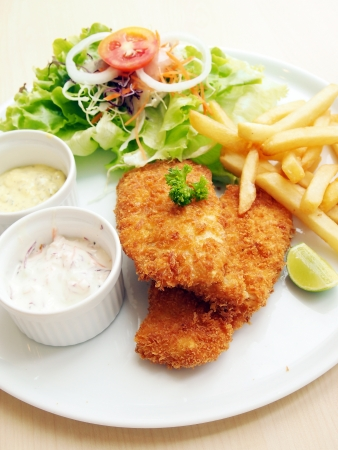 takeaway: Fried fish with fresh salad and dipping sauce as condiment