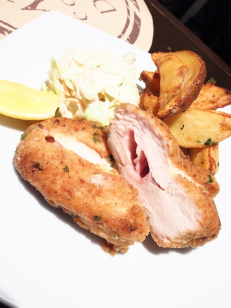 Chicken stuffed with cheese and ham. photo