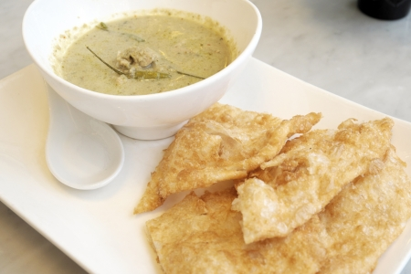 Thai food: green curry with coconut milk and fried Roti photo