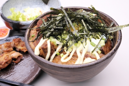 Japanese steamed rice with pork. photo