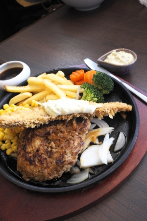 Beef steak with fried fish. photo