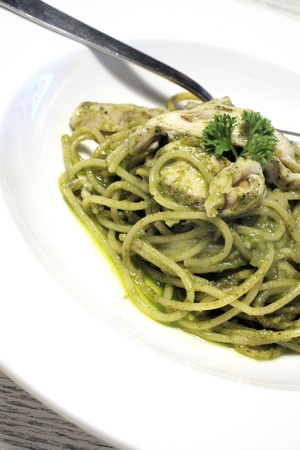 spaghetti with pesto sauce photo