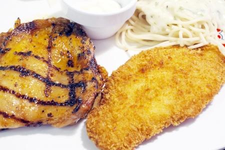 chicken steak with fried fish.  photo