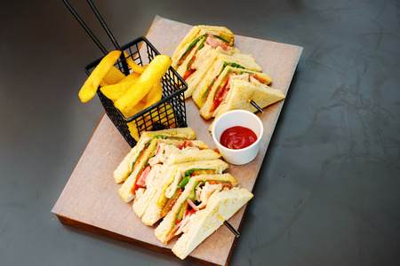 cuisine entertainment: Sandwich with chicken, cheese and French fries potatoes