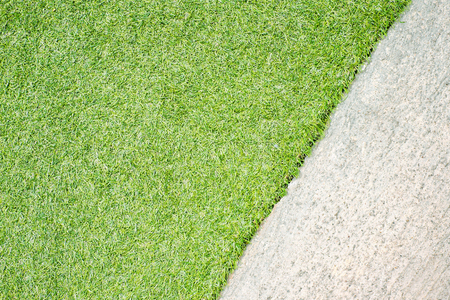 concrete texture: Green grass natural background and concrete floor. Stock Photo