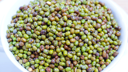 green mung beans isolated on white