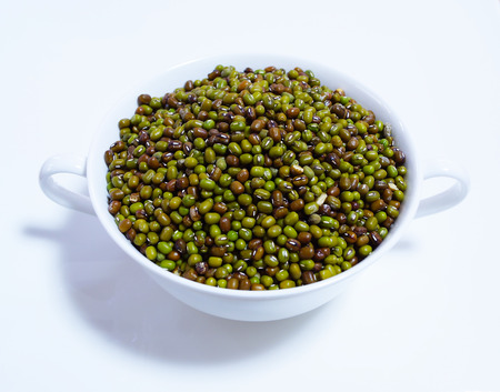 munggo: green mung beans isolated on white