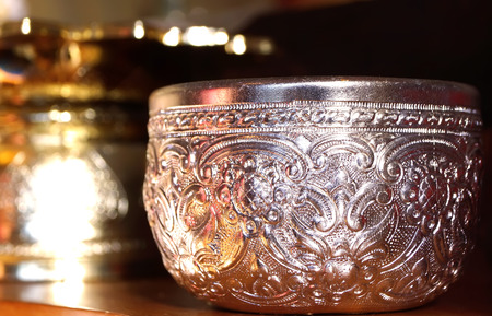 Silver bowls of water for use in the temple photo