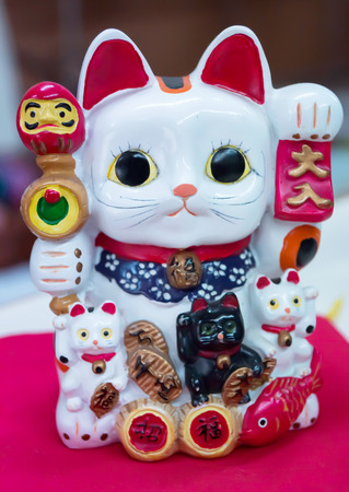 maneki: Classic japanese maneki-neko (lucky cat) Stock Photo