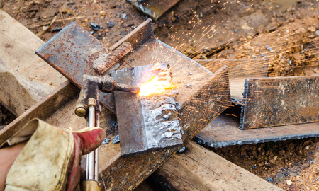 photo of worker doing gas cutting on steel Stock Photo
