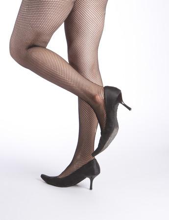 fishnet: legs in fishnet stockings