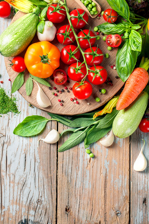 flavouring: Summer Vegetables set for cooking. Bio Organic food. Food background with copy space. Homemade Healthy Cooking concept. Vegetarian eating. Seasonal ingredients. Stock Photo