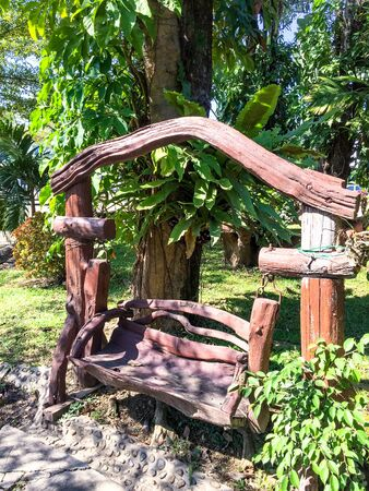 Wooden swing in the green tree gardent, art and craft