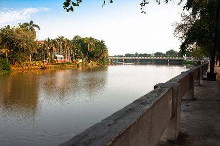 Closest Hotels to Mae Ping River in Chiang Mai Thailand. River city. Cleared, reflection. Chiang Mai city view has been pictured from Mae Ping river that is the most famous river in northern region of Thailand