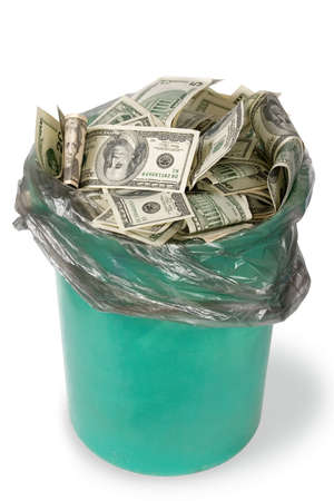 unneeded: Money in dustbin Stock Photo