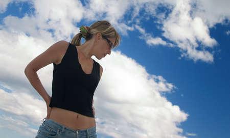 Girl sensitively looks downwards photo