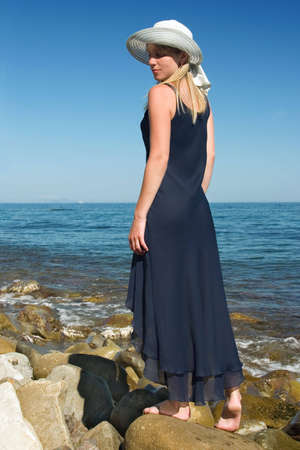 The girl in a dress on stones Stock Photo - 560258