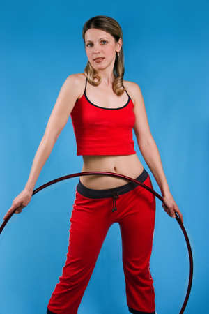 Girl with hoop  on blue background photo